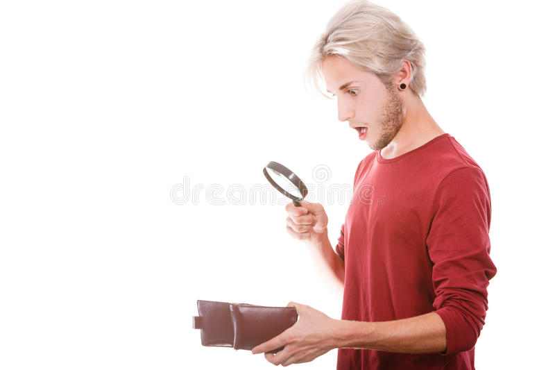 Young man with empty wallet royalty free stock image