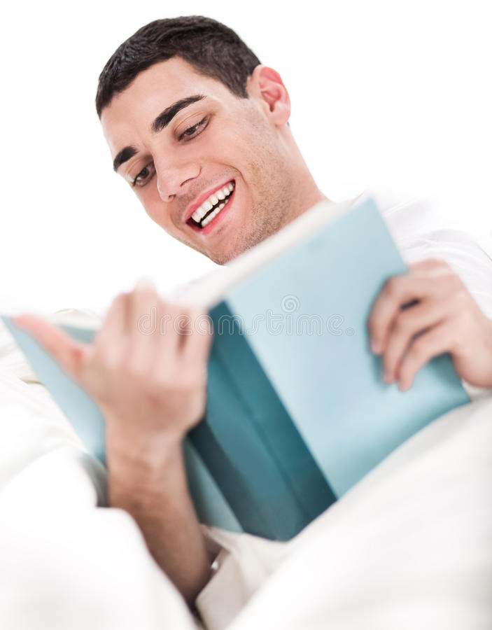 Young man enjoy reading book royalty free stock images
