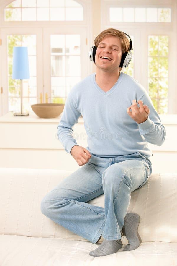 Young Man Enjoying Music Royalty Free Stock Images