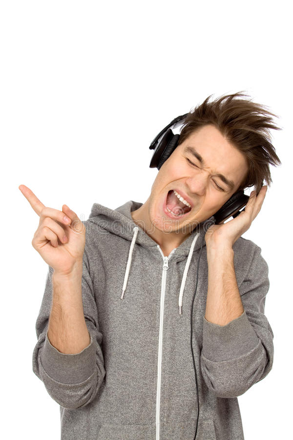 Download Young man enjoying music stock image. Image of excitement - 18397471