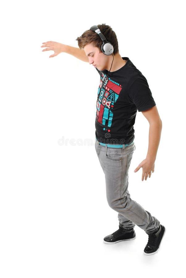 Young man enjoying music isolated stock photos