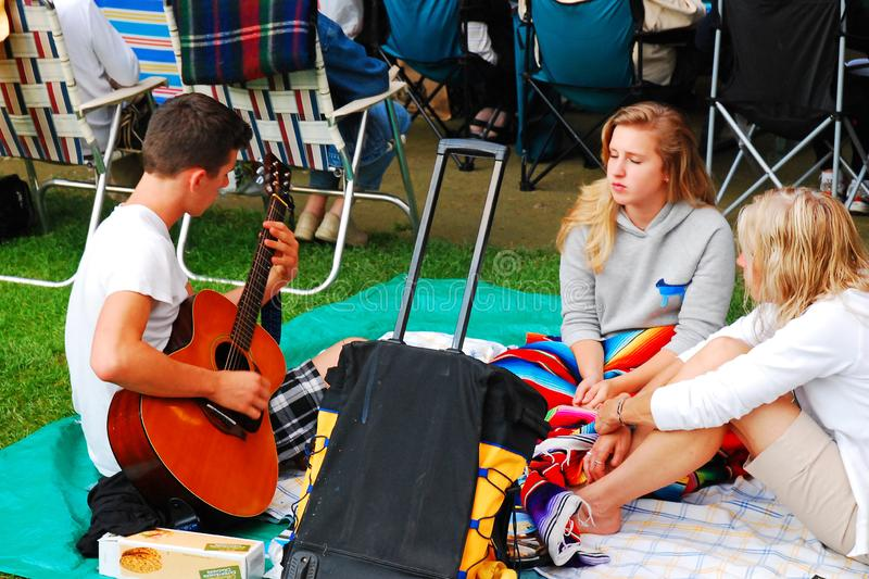 A young man entertains his friends. At a music festival in Lenox, Massachusetts stock photos