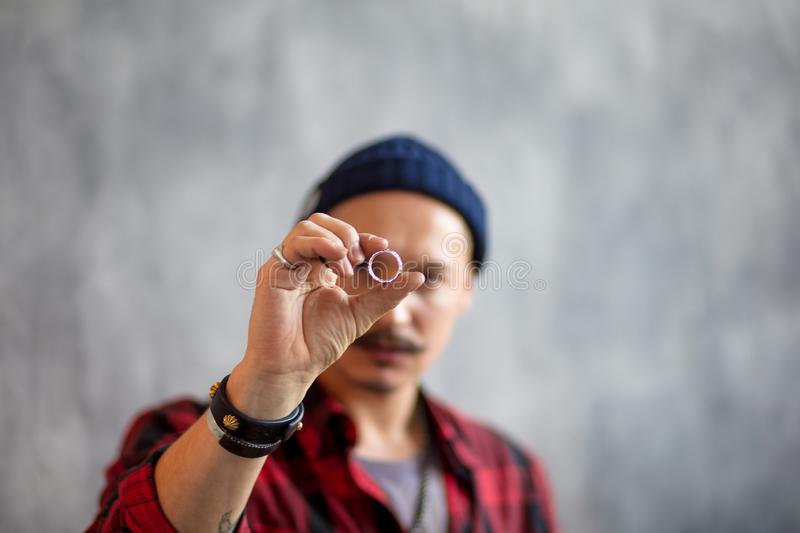 Young man evaluating the ring. Close up photo.focus on the luxury expensive ring, crime concept royalty free stock image