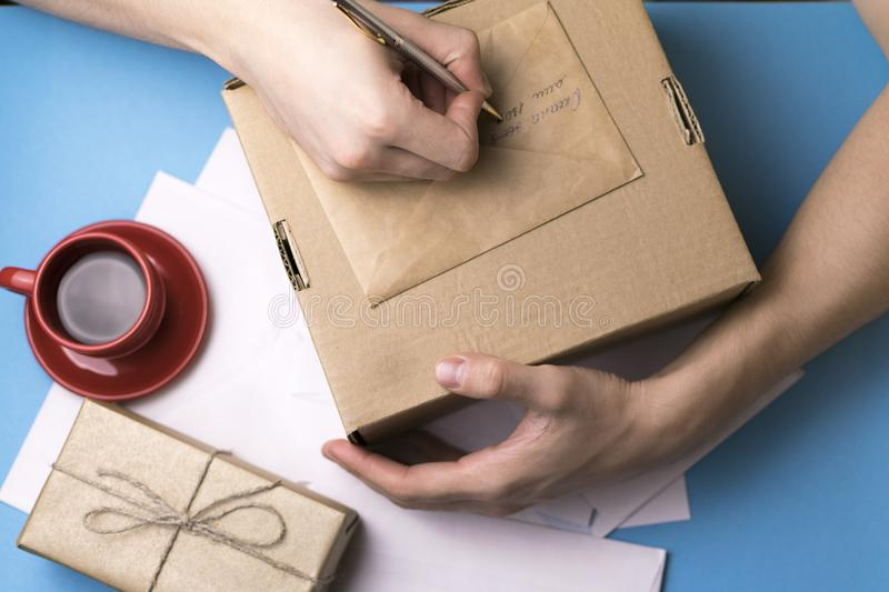 A young man examines and signs the letter. The concept of correspondence. stock photo