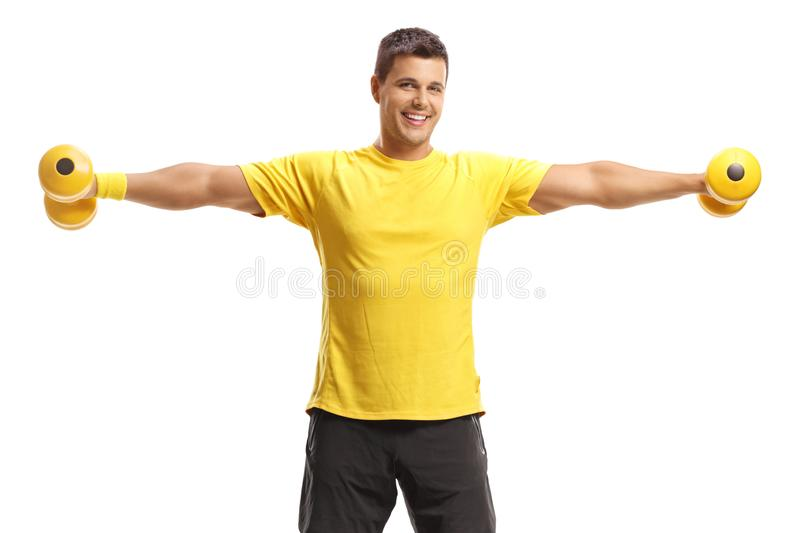 Young man exercising with dumbbells royalty free stock photo