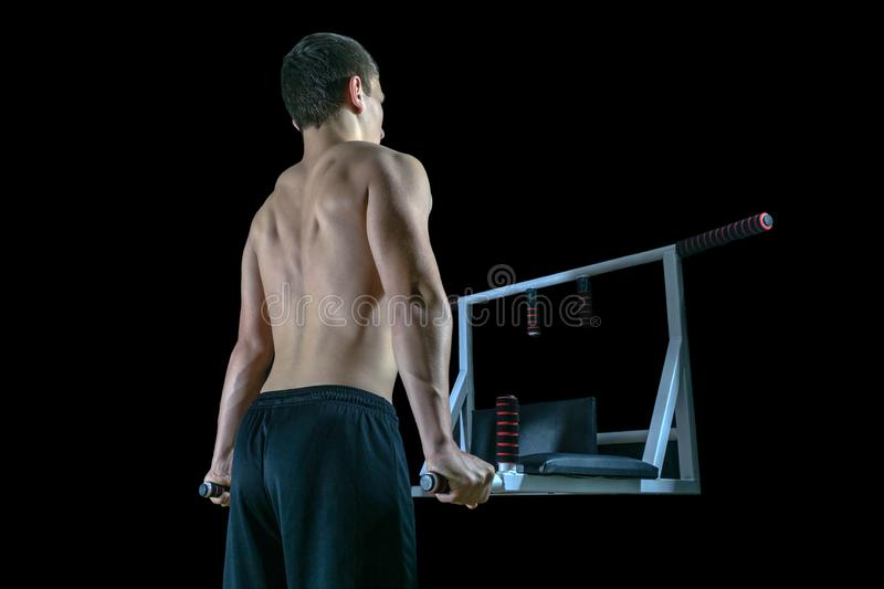 Young man exercising on the home parallel bars. stock images