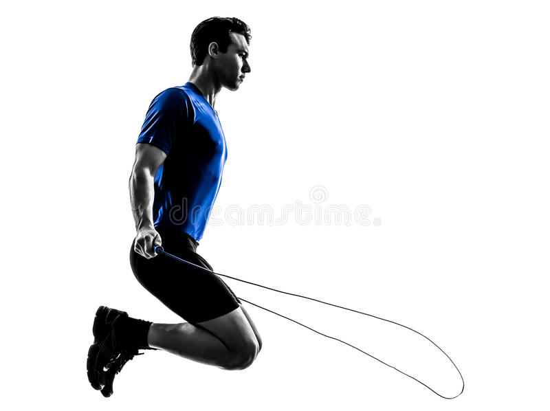 Young man exercising jumping rope silhouette. One caucasian man exercising jumping rope in silhouette studio on white background royalty free stock photography
