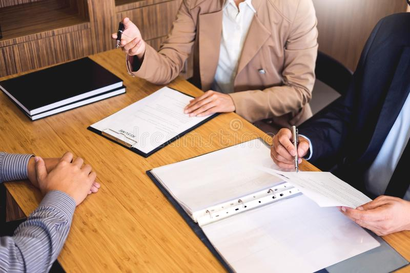 Young man explaining about his profile to business managers sitting in job Interview. listen to candidate answers Hiring employee. Nervously clutched scolded stock photos