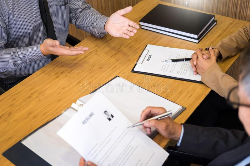 Young man explaining about his profile to business managers sitting in job Interview. listen to candidate answers Hiring employee. Nervously clutched scolded royalty free stock images