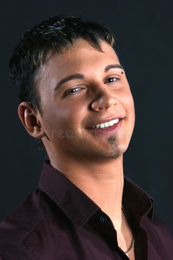 Young man with eyebrow piercing royalty free stock photos