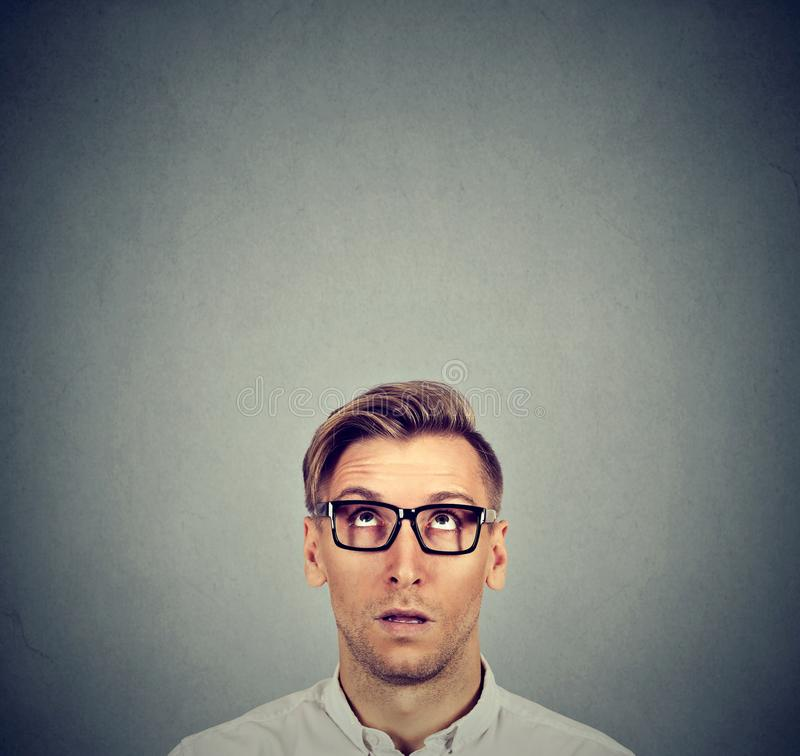 Doubtful young man looking perplexed royalty free stock photos