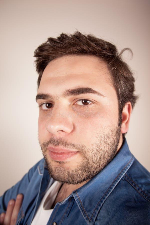 Young man facial expression stock image