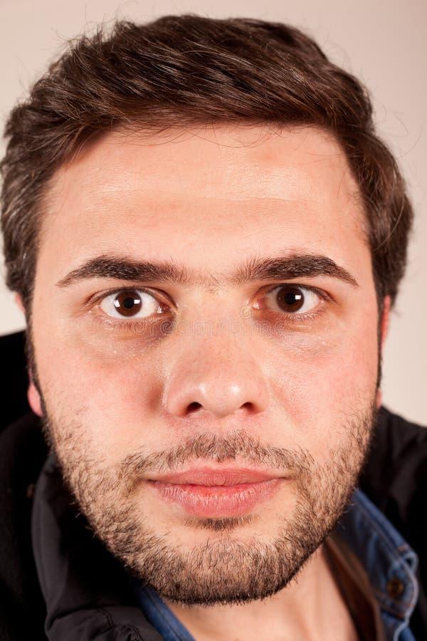 Young man facial expression stock photos