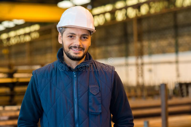 Young man in factory. Man stock photography