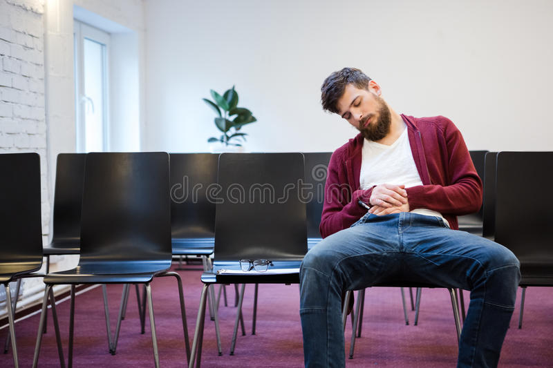 Young man falling asleep at conference room royalty free stock photo