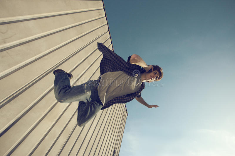 Download Young Man Is Falling From A Building Stock Photo - Image of dangerous, answer: 27887634