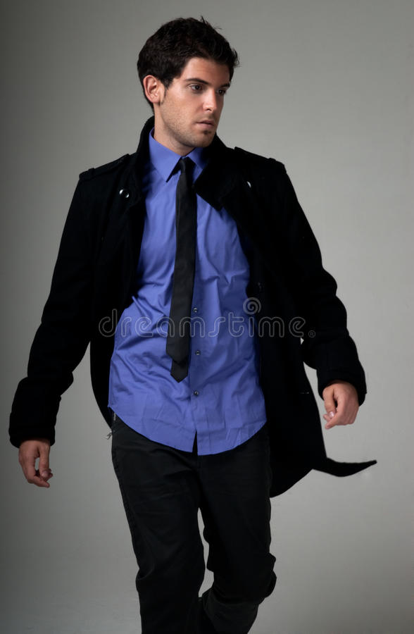 Download Young Man Fashion Suit Walking Over Grey Stock Image - Image: 23788897