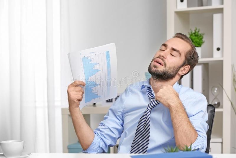 Young man feeling hot stock photo