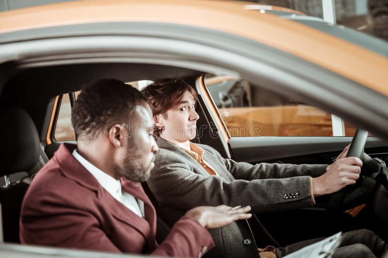 Young man feeling worried before passing his driving exam royalty free stock photos