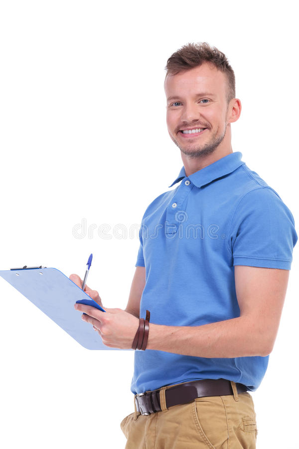Young man fills out a form stock photo