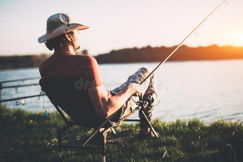 Young man fishing at pond and enjoying hobby. Activities stock images
