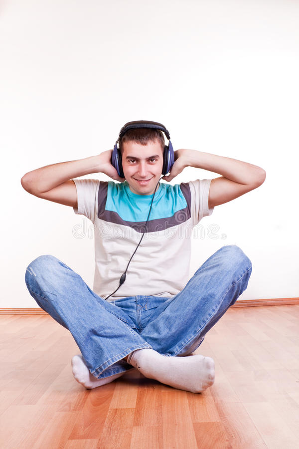 Download Young Man On The Floor With Earphones Stock Photo - Image: 13499970