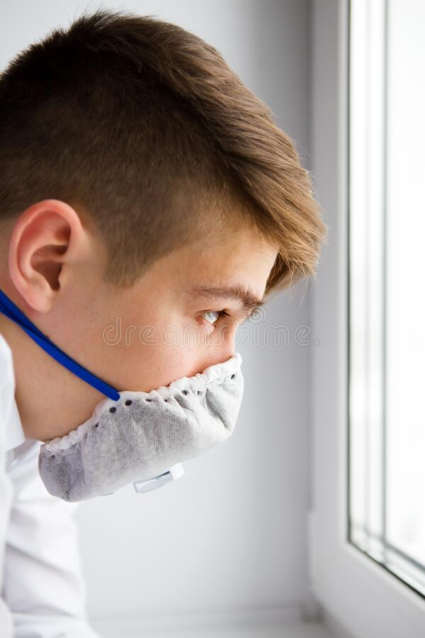 Young Man in Flu Mask stock photos