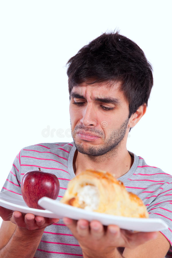 Download Young man food temptation stock image. Image of food - 18197949