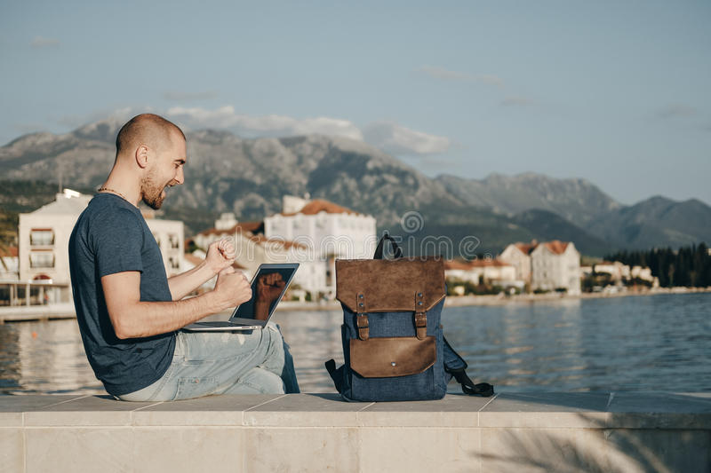Young man freelancer working with laptop and Achieved success si stock image
