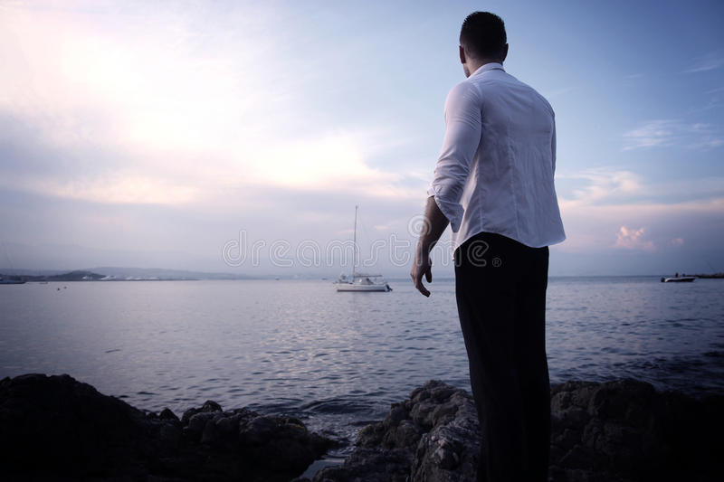 Young man in front of the sea stock photos