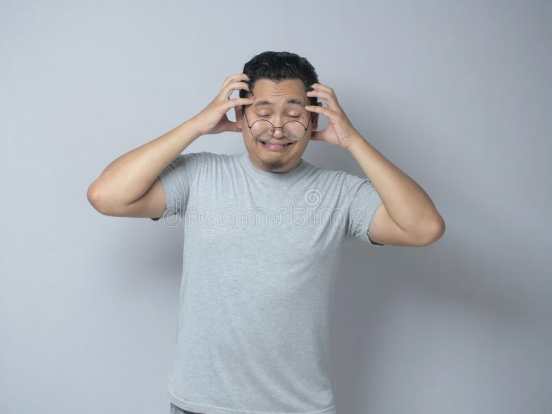 Young Man Frustrated, headache, stress and dizzy gesture royalty free stock image
