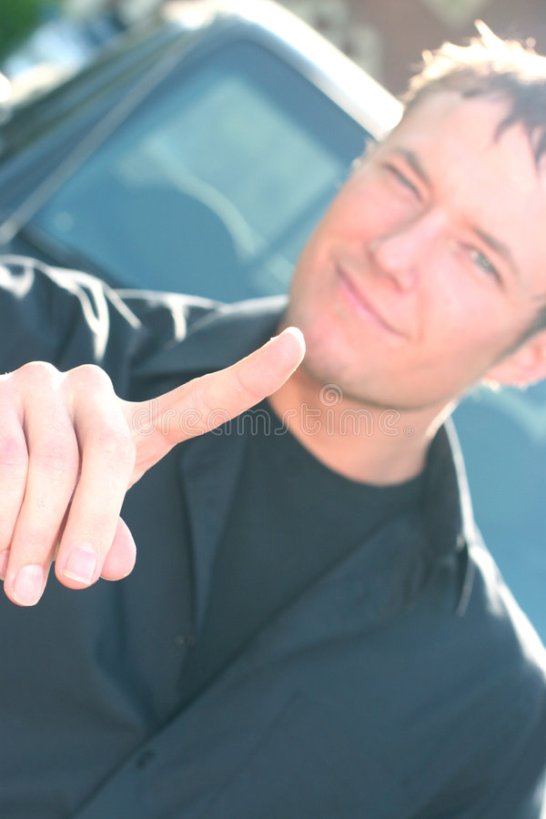 Young man gestures with an extended finger stock images