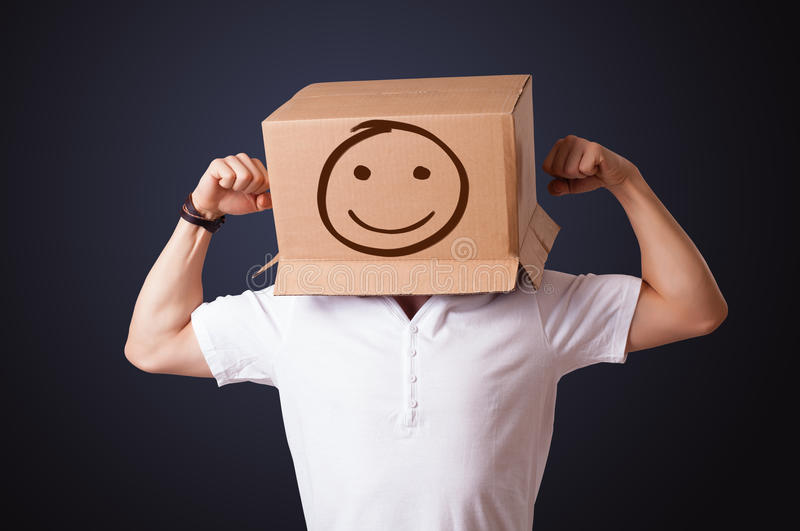 Download Young Man Gesturing With A Cardboard Box On His Head With Smiley Stock Photo - Image: 32260248