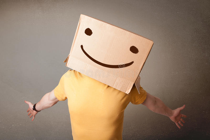 Download Young Man Gesturing With A Cardboard Box On His Head With Smiley Stock Image - Image: 32419637