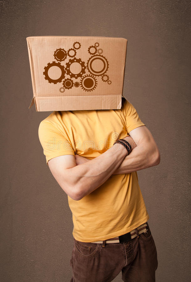 Download Young Man Gesturing With A Cardboard Box On His Head With Spur W Stock Photo - Image: 38547836