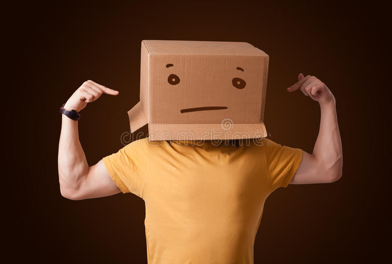 Download Young Man Gesturing With A Cardboard Box On His Head With Straig Stock Image - Image: 38305593