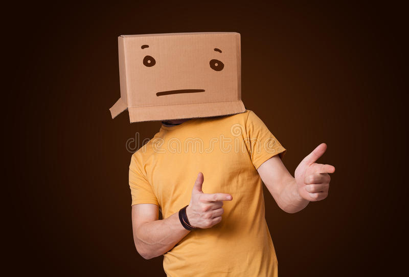 Download Young Man Gesturing With A Cardboard Box On His Head With Straig Stock Image - Image: 32260247