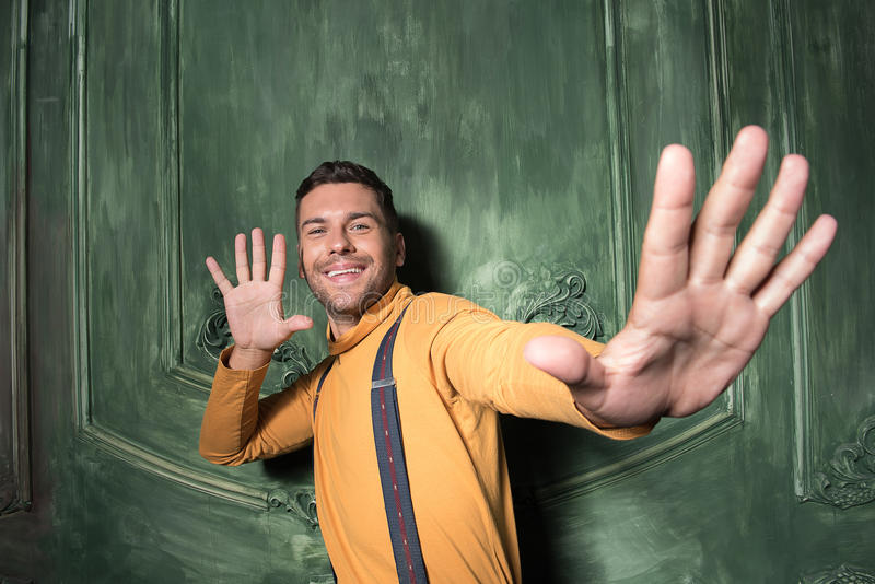 Young man is gesturing with excitement stock image