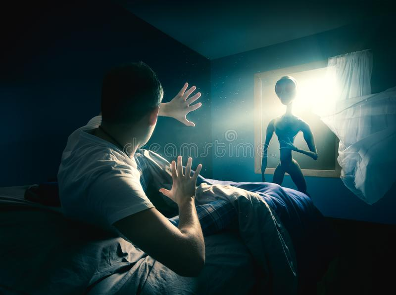 Young man getting abducted stock photos