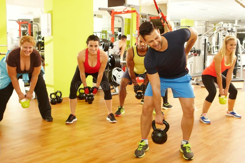 Young man getting injured in fitness club royalty free stock photo