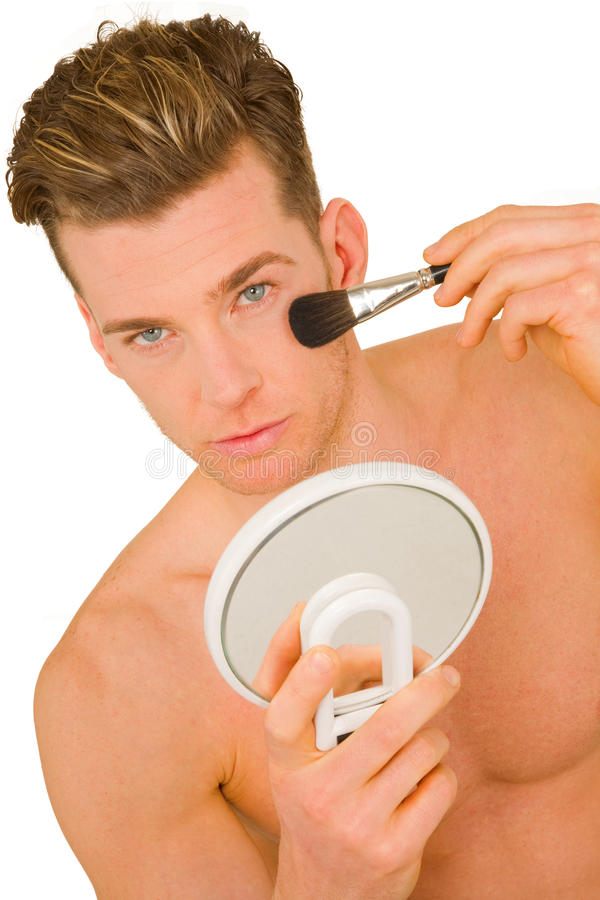 Young man getting makeup. On white background stock photos