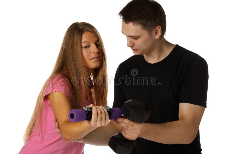 Download Young Man And The Girl With Dumbbells Royalty Free Stock Photography - Image: 12221327