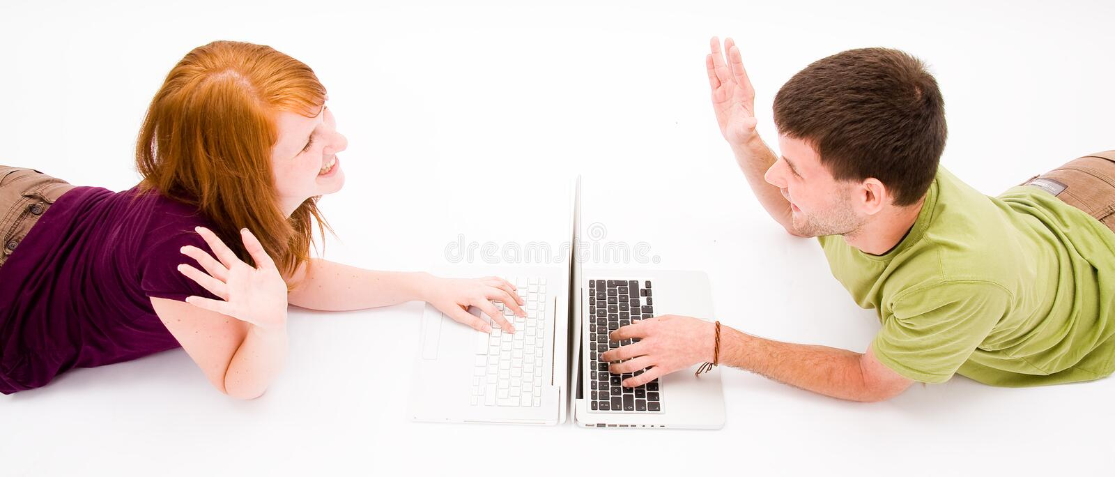 Young man and girl with laptop computer royalty free stock images