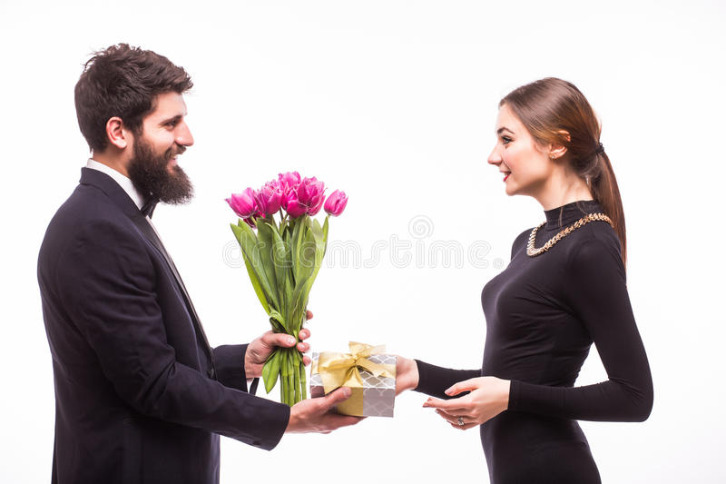 Young man give a gift for his girlfriend and tulips bucket stock images