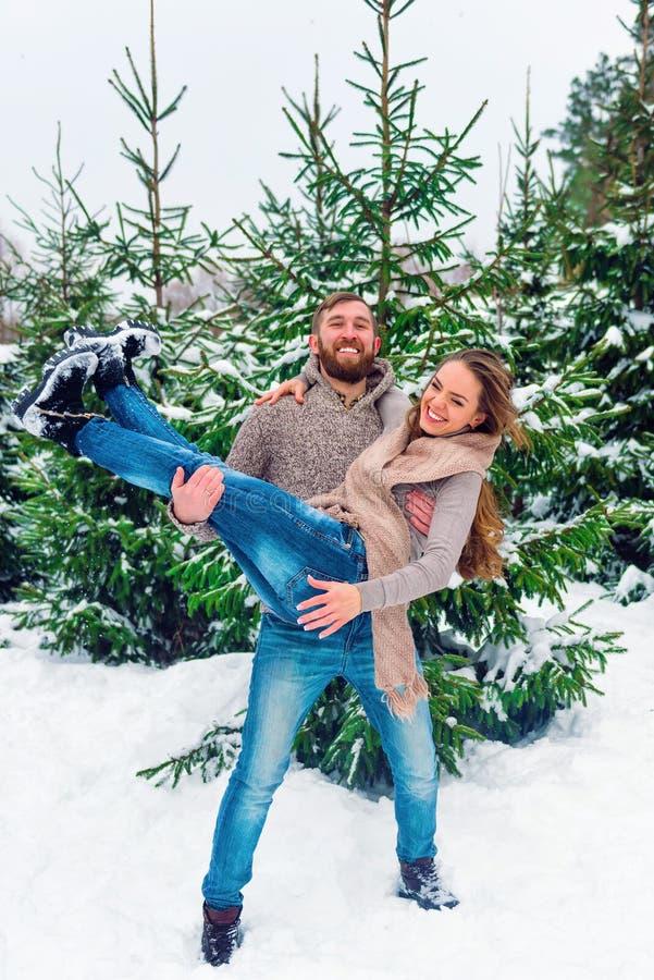 Young man giving girlfriend a piggyback ride stock photo