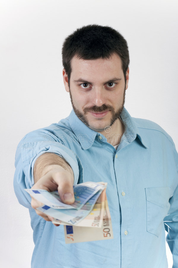 Young man giving money stock images