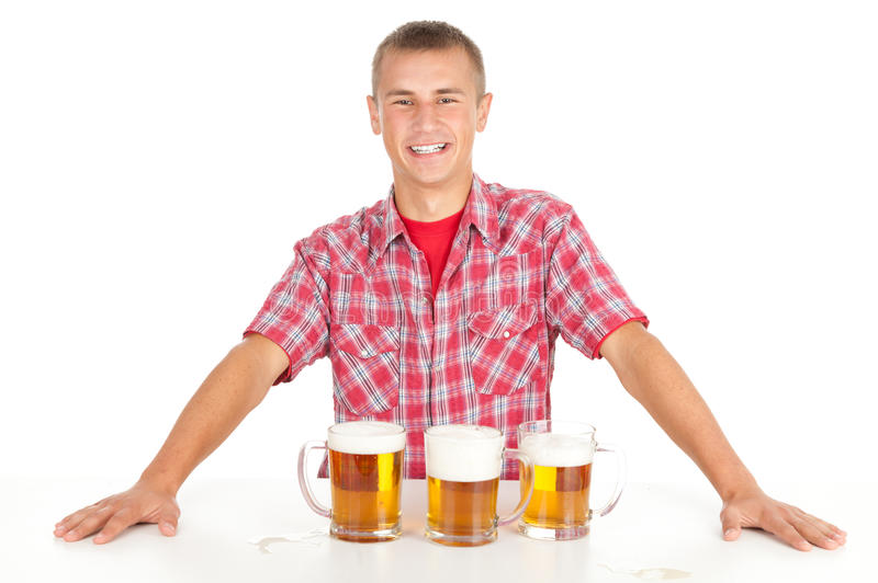 Young man giving mugs of beer