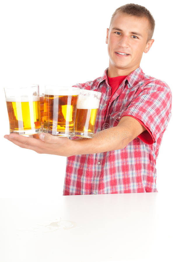 Download Young Man Giving Mugs Of Beer Stock Photo - Image: 21701308
