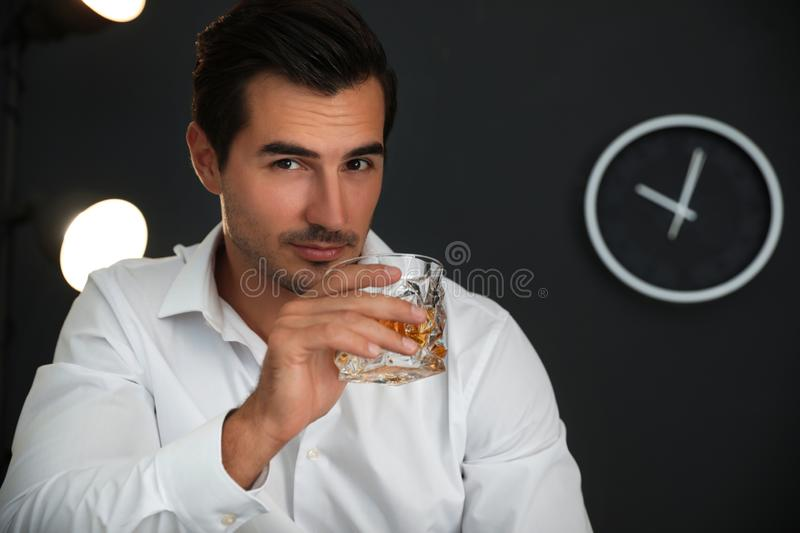 Young man  glass of whiskey at home. Space for text. Young man with glass of whiskey at home. Space for text royalty free stock photography