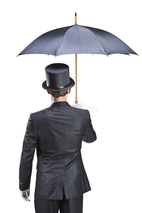 Young man with gloves holding an umbrella stock photos